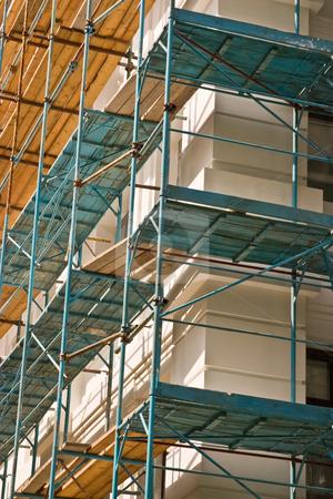 Under construction stock photo, Building series: new building under construction with falsework by Gennady Kravetsky