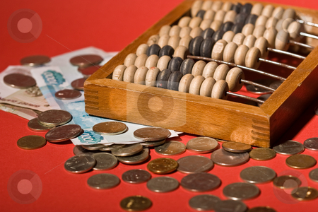 Counting frame stock photo, Money series: old counting frame, coins and banknotes by Gennady Kravetsky