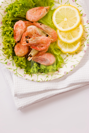 Shrimp stock photo, Food series: tasty shrimp with lemon and lettuce by Gennady Kravetsky