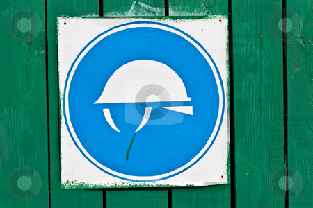 Construction safety sign stock photo, Building series: construction safety symbol on the fence by Gennady Kravetsky