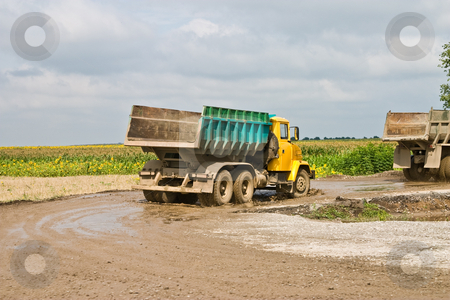 Dump-track stock photo, Building series: special road building vehicle on the way by Gennady Kravetsky