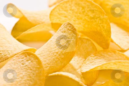 Potato chips stock photo, Food series: golden background of potato chips by Gennady Kravetsky