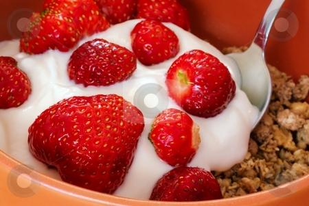 Detail of strawberries with cereals stock photo, Detail of strawberry with yogurt and cereals and metal spoon in orange bowl by Juraj Kovacik