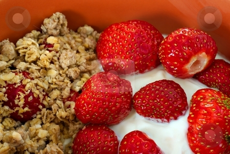 Strawbery yogurt and cereals stock photo, Cereals with strawberry and yogurt in orange bowl by Juraj Kovacik