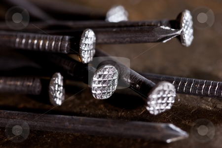 Nail stock photo, Tools series: metal nails on the steel plate by Gennady Kravetsky