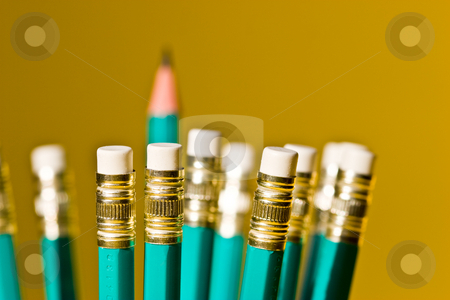 Pencil stock photo, Stationery series: pencils with eraser over yellow background by Gennady Kravetsky