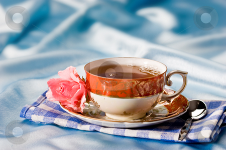 Cup of tea stock photo, Cup of tea with flower over azure by Gennady Kravetsky