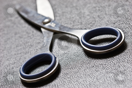 Scissor stock photo, Photo of blue scissors on texture imitation leather by Gennady Kravetsky