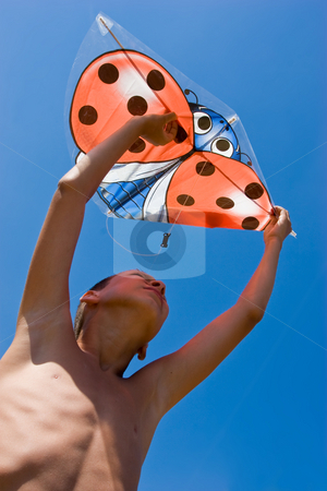 Playing the kite stock photo, Vacation, portrait of summer boy with kite by Gennady Kravetsky