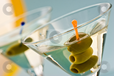 Martini stock photo, One bocal of martini with olive over blue by Gennady Kravetsky