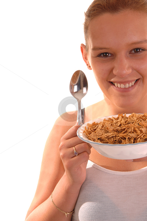 Smiling woman with cereal. stock photo, An lovely young woman holding a bowl of cereal and the spoon is ready to have her healthy breakfast. by Horst Petzold