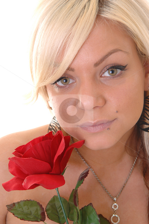 Beautiful blond girl. stock photo, Very lovely young blond girl with an red rose in her hand and a diamond necklace around the neck in a portrait shot in close up. by Horst Petzold