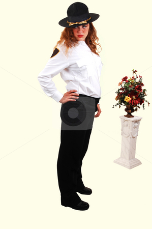 Pretty security guard. stock photo, A lovely security guard from an shopping mall in the US in her good looking uniform with bright red hair. by Horst Petzold