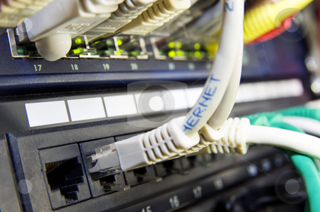 Ethernet switch stock photo, Eternet switch and patch panel in a professional server configuration by Corepics VOF
