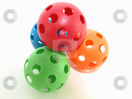 Play Balls stock photo, Colorful plastic balls with holes isolated on a white background. by Robert Gebbie