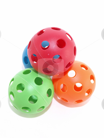 Stacked Toy Balls stock photo, Colorful plastic balls with holes isolated on a white background. by Robert Gebbie
