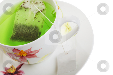Herbal tea stock photo, Green tea in a white cup on a white background by Steve Mcsweeny