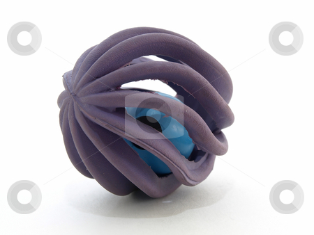 Cat Jingle Ball stock photo, Purple colored rubber ball with a bell inside. Isolated over a white background. by Robert Gebbie