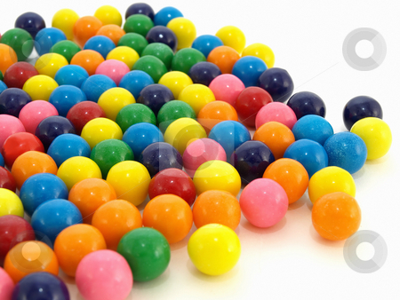 Gumballs over White stock photo, A colorful variety of gumballs in a close but random pattern. by Robert Gebbie