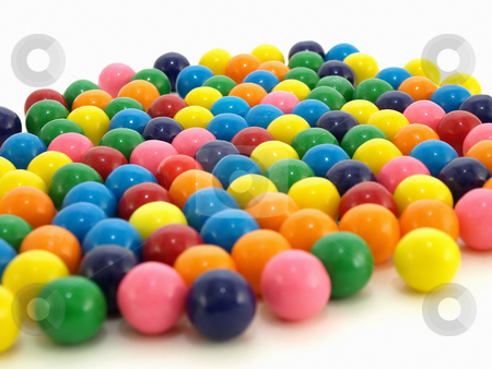 Sweet Gumballs stock photo, A colorful variety of gumballs spilled out on a white background. by Robert Gebbie