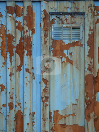Rusty Blue Door stock photo, A rusty old metal building, flaking and peeling.  View of door and frame with vent. by Robert Gebbie