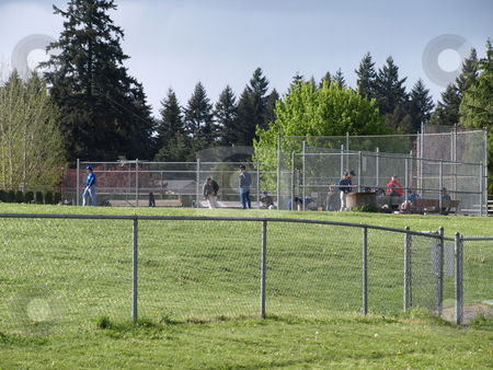 Before the Game stock photo, A group of ball players gathering up for a game at a baseball diamond in Vancouver, WA. by Robert Gebbie