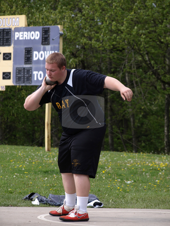 Student with Shot Put stock photo, Local Track and Field Event between rivals Columbia River High School and visiting team Hudson?? by Robert Gebbie
