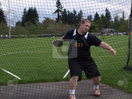 Bay Student Throws Discus stock photo, Local Track and Field Event between rivals Columbia River High School and visiting team Hudson?? by Robert Gebbie