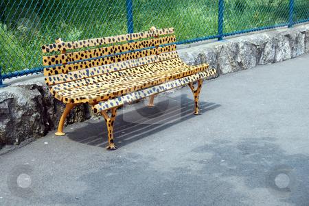 Bench in animal design stock photo, Yellow spotted bench in animal design in park outdoor by Julija Sapic