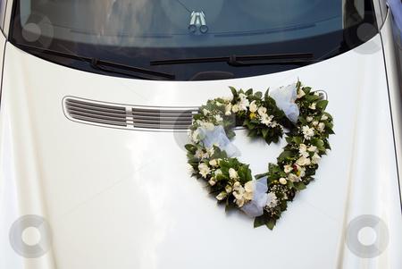 Wedding car stock photo, Wedding wreath decoration in heart shape on white car by Julija Sapic