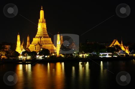 Wat Arun stock photo, Night shot of Wat Arun across the ChaoPhraya River. Bangkok, Thailand by Martin Darley