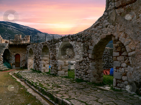 Ancient arches stock photo, Ancient arches in the site of a monastery in Greece under a beautiful sunset by Casinozack