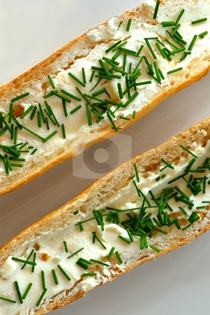 Bread rolls with chives diagonal stock photo, Diagonal composition of two bread rolls with cheese and chives on white plate by Juraj Kovacik