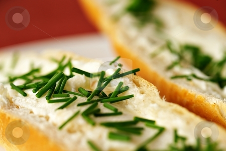 Big detail of bread roll with chives stock photo, Close up detail of bread roll with cheese and chives, shallow DOF, red - purple background, white plate, by Juraj Kovacik