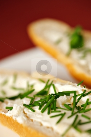 Big detail of bread roll with chives vertical stock photo, Close up detail of bread roll with cheese and chives, shallow DOF, red - purple background, white plate, vertical composition by Juraj Kovacik