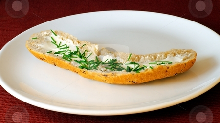 Bread roll on a plate stock photo, Bread roll with cheese and chives on white plate with red-purple background by Juraj Kovacik