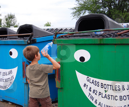 Young boy recycles 2 stock photo,  by Heather Shelley