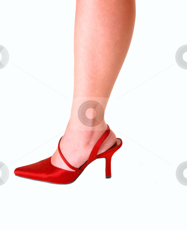 Womans leg in high heels. stock photo, Young womans leg in red high heels for light blue background. by Horst Petzold