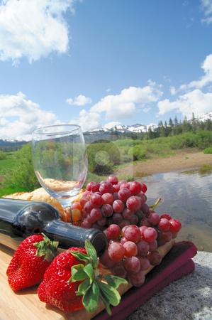 Strawberries, Grapes And Red Wine stock photo, Fruit and Wine picnic in a scenic mountain setting on a bright sunny day by Lynn Bendickson