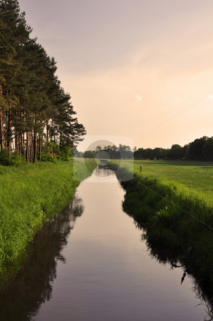 Sunset stock photo, Idylllic sunset over a canal by Nils Volkmer