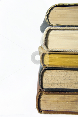 Stacking books stock photo, Old books stacking like a tower by Nils Volkmer