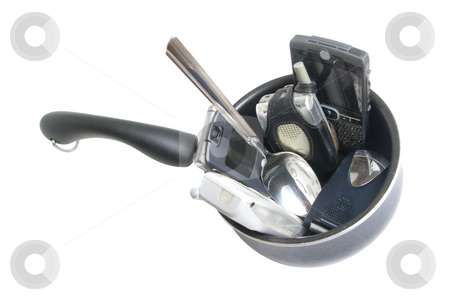 Stirring the Pot stock photo, Sauce pan with various cells phone and serving spoon, isolated on white background. by Steve Carroll