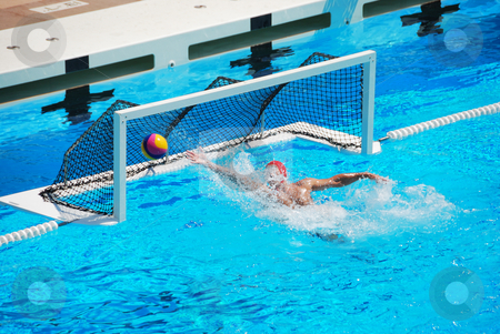 Water Polo Goal stock photo, A water polo goalkeeper misses the ball going into the net of the goal. by Denis Radovanovic