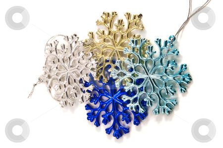 Christmas Snowflake Decoroations stock photo, Multicolored snowflake shaped christmas decorations by Steve Carroll