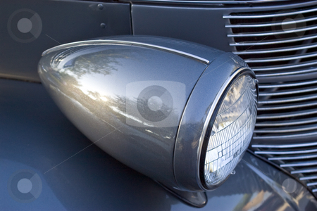 Vintage Headlight stock photo, Headlight assembly of a 1946 antique automobile by Steve Carroll