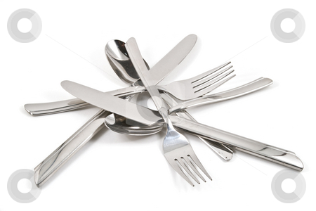 A pile of flatware. stock photo, A pile of stainless steel flatware on a white background. by Steve Carroll