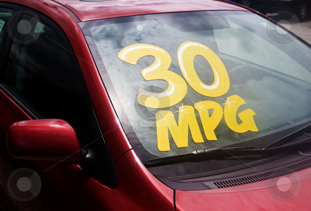 30 MPG stock photo, Car dealer displaying hight miles per gallon on new cars. by Steve Carroll