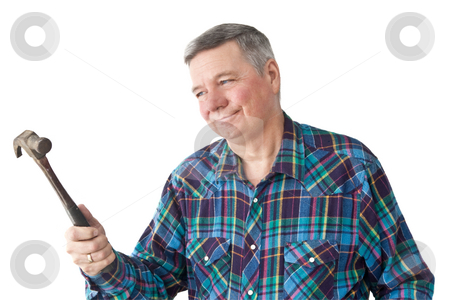 Mature Handyman Admiring Hammer stock photo, Mature Handyman admiring the hammer he is holding, isolated on a white background. by Steve Carroll