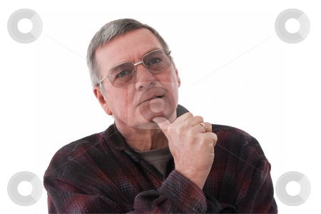 Portrait of senior man lost in thought, isolated on white. stock photo, Portrait of 57 year old senior man wearing a dark flannel shirt, deep in thought, isolated on white background. by Steve Carroll
