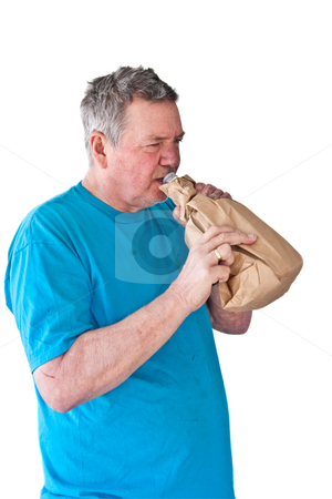 Distraught Mature Man Drinking Booze from Paper Bag stock photo, Distraught mature man drinking booze from a paper bag, isolated on white background. by Steve Carroll